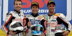 Los pilotos del Effenbert-Liberty Racing en el podio